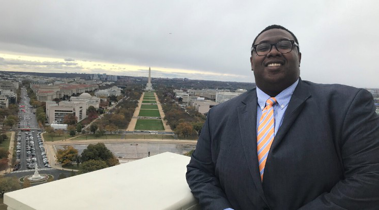 Marcus Wright standing in front of the mall in Washington D.C.